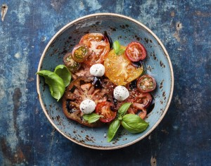 Ripe fresh colorful tomatoes salad with olive oil and balsamic v